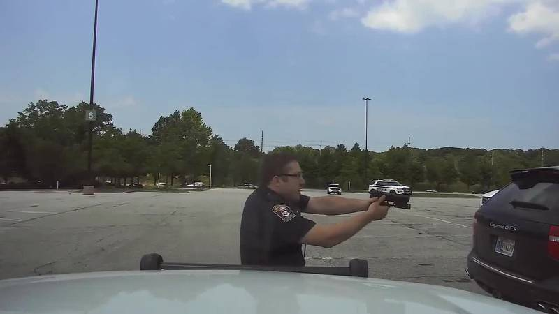 WARNING GRAPHIC LANGUAGE: Footage from BPD dash camera captured the moment a police officer...