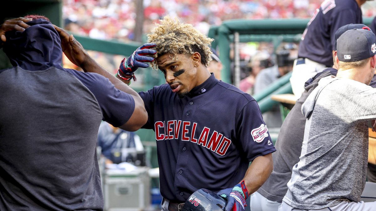 Cleveland Indians' Francisco Lindor returns to the dugout after scoring on a solo home run...