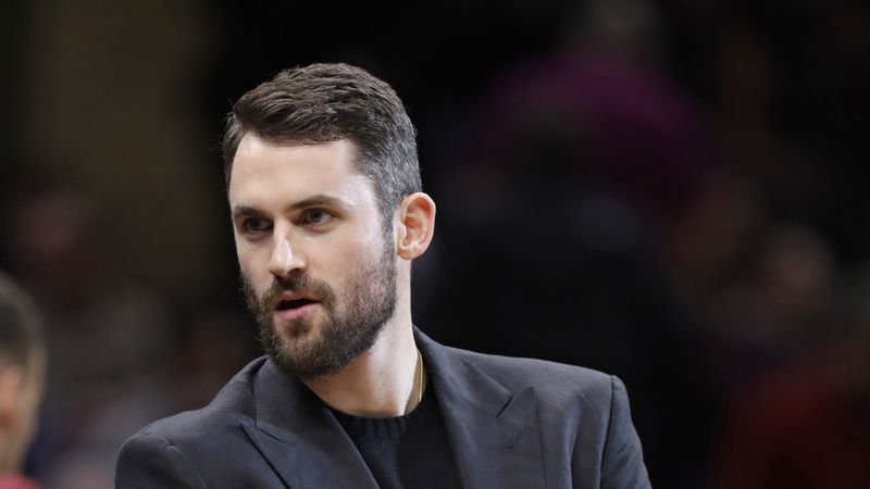 Cleveland Cavaliers' Kevin Love is shown during a timeout in the second half of an NBA...