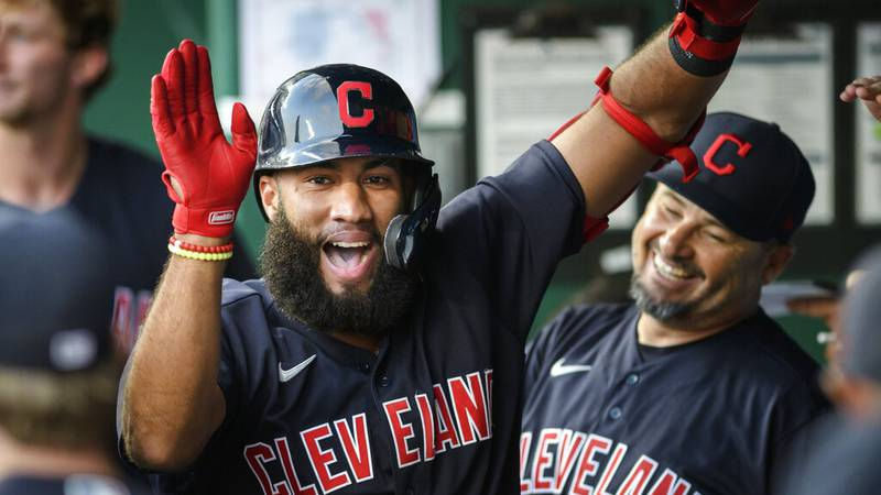 Cleveland Indians' Amed Rosario celebrates his inside-the-park home run against the Kansas City...
