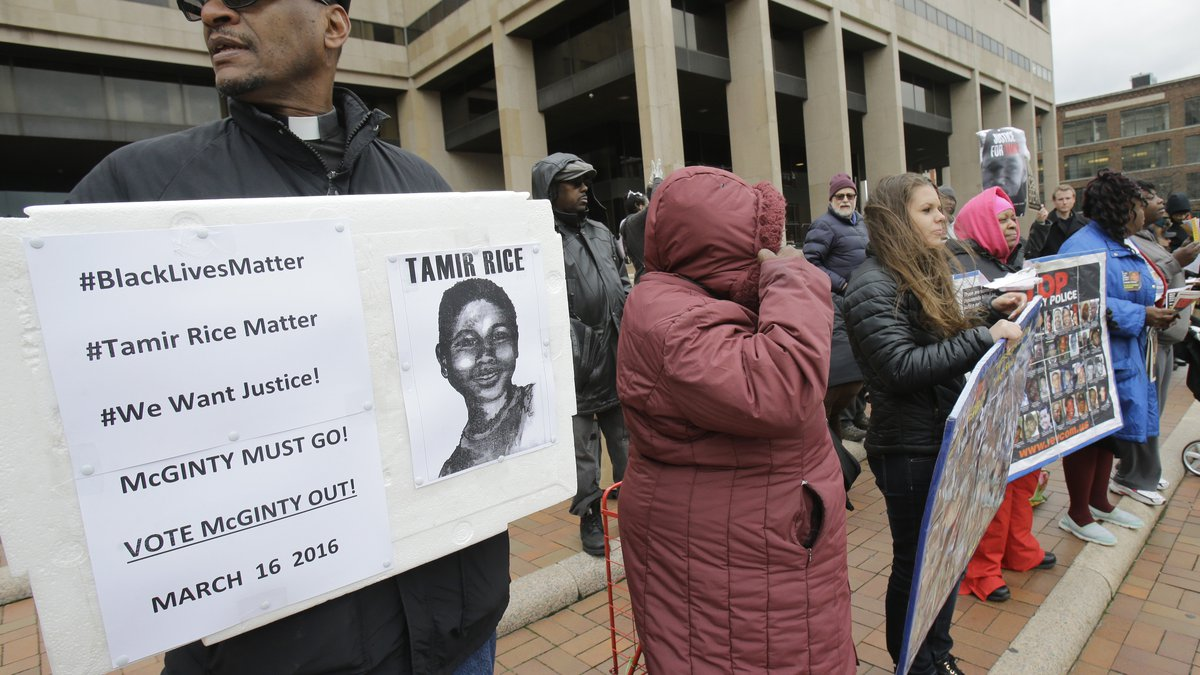 Rev. Bruce Butcher, left, protests outside the Cuyahoga County Justice Center, Tuesday, Dec....