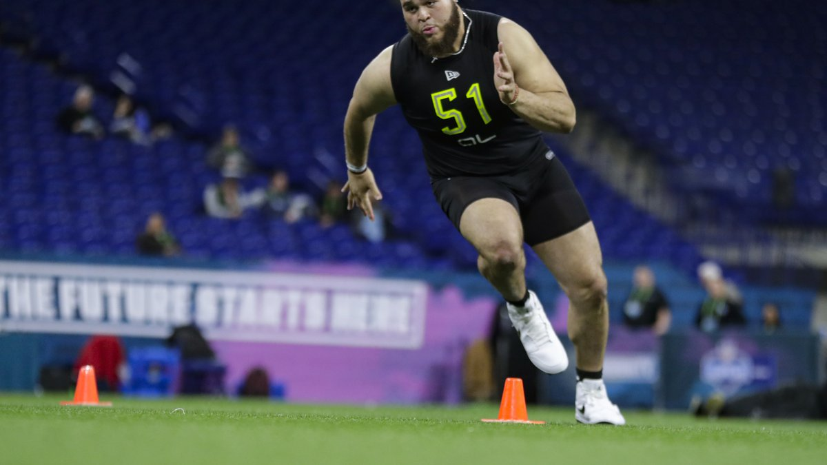 Alabama offensive lineman Jedrick Wills runs a drill at the NFL football scouting combine in...