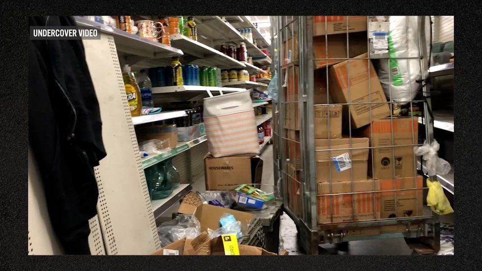 A cart and boxes block the aisle at the Dollar General at E. 157th & St Clair Ave.