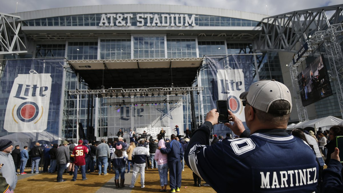 Fans arrive to AT&T Stadium for for an NFL football game between the Dallas Cowboys and the...
