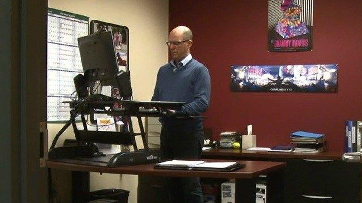 WOIO marketing director Rob Boenau prefers to stand while working. (Source: WOIO)