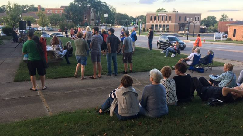 A crowd gathers outside the First Christian Church in Cuyahoga Falls.