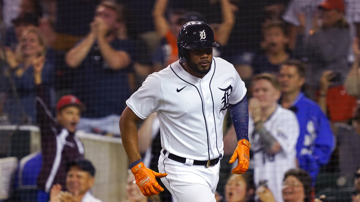 Detroit Tigers' Jeimer Candelario scores during the eighth inning of a baseball game against...
