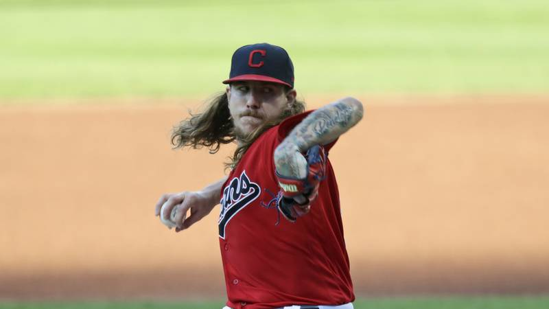 Cleveland Indians starting pitcher Mike Clevinger delivers in the first inning in a baseball...