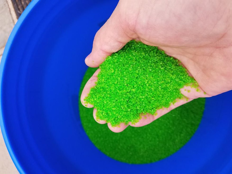 The green comes from grounded down pieces of recycled glass, glued to a surface. (Source: Bike...