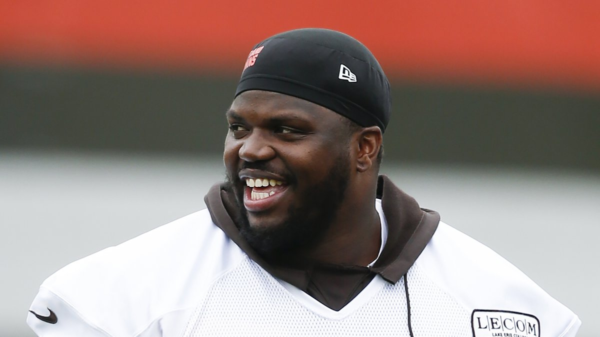 FILE - In this May 22, 2019, file photo, Cleveland Browns' Greg Robinson walks off the field...
