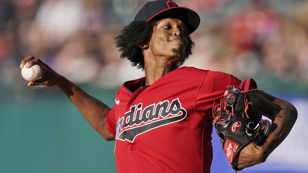 Cleveland Indians starting pitcher Triston McKenzie delivers in the first inning of a baseball...