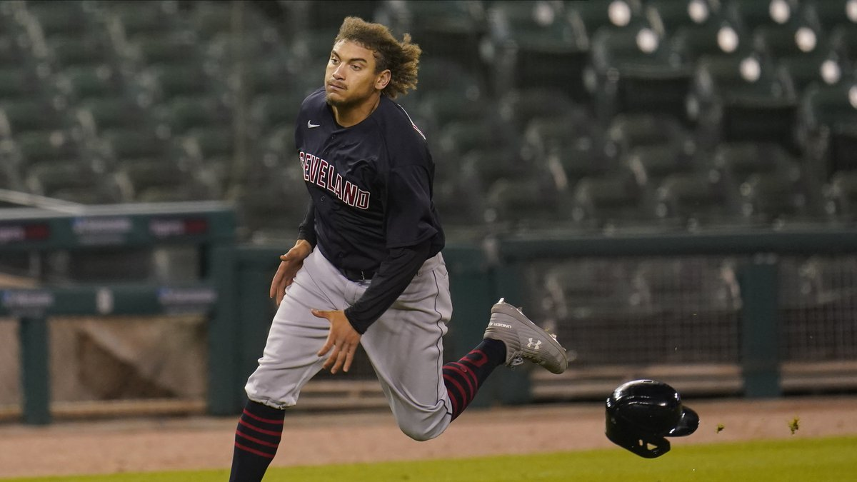 Cleveland Indians' Josh Naylor loses his helmet rounding third base while scoring in the eighth...
