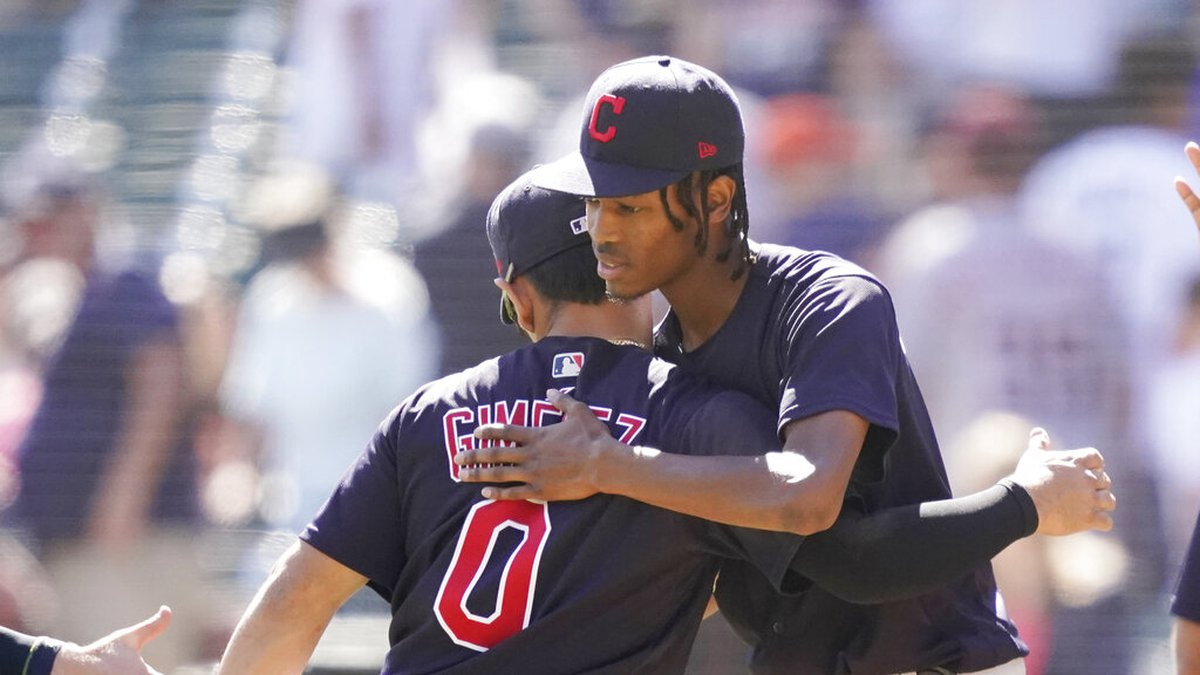 Cleveland Indians starting pitcher Triston McKenzie, right, is greeted by teammate Andres...