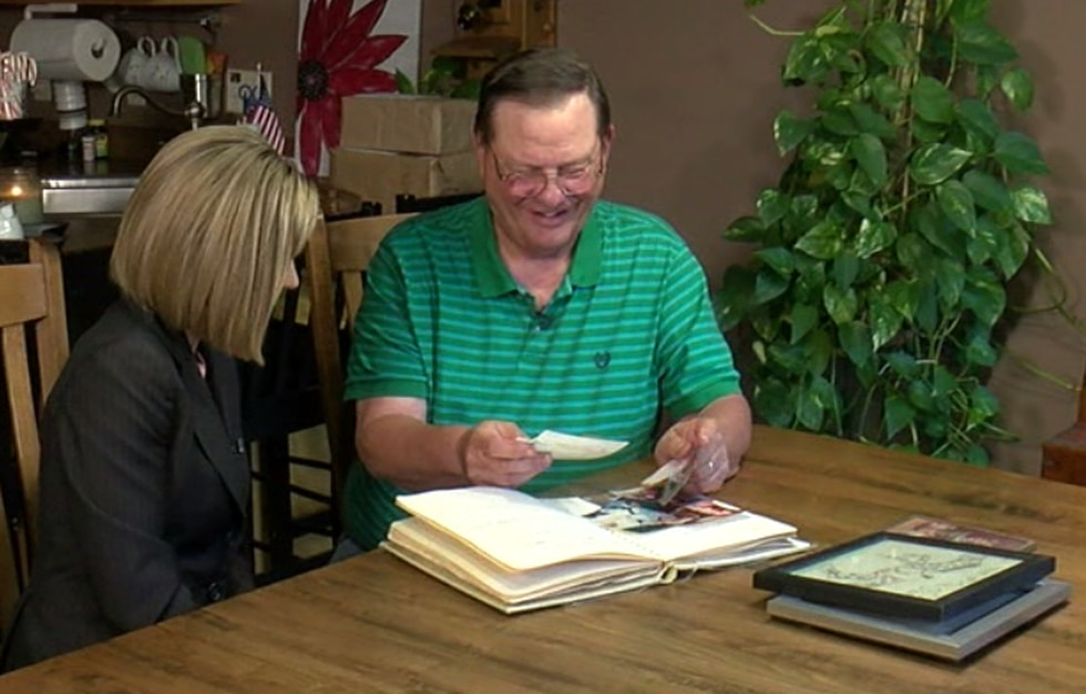 Amy's dad, Mark Mihaljevic, sifts through a picture album with Nichole Vrsansky.