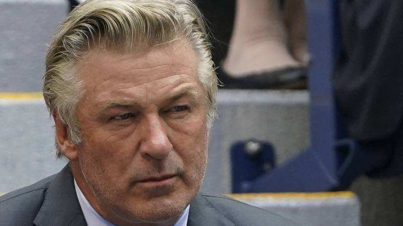 In this Sunday, Sept. 12, 2021, photo Alec Baldwin watches the men's singles final of the US...
