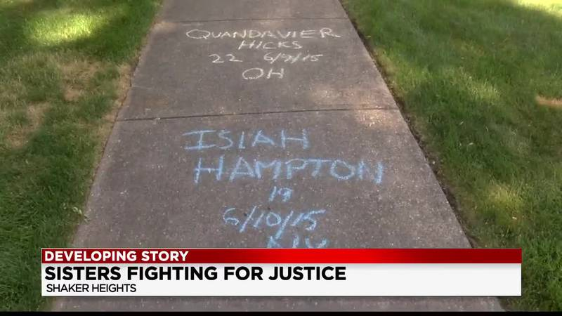 Shaker Heights sisters use chalk on sidewalks to write names of police brutality victims...