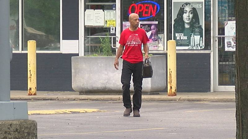 A man walks out of a small food mart near the site of the former Dave's Supermarket in...